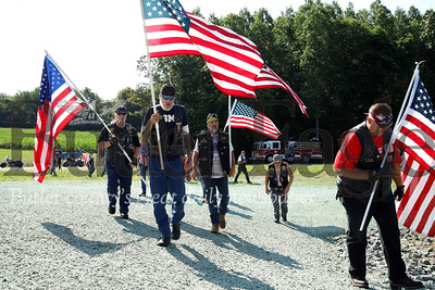 Local veterans' motorcycle clubs showed up in force to honor veteran Justin Erickson and his wife Jennie and welcome them to their new Homes for Troops house Saturday. Seb Foltz/Butler Eagle 08/03/19