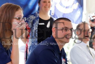 Jennie and Justin Hendrickson react to a surprise gift from contractors who helped build their Homes for Troops house. Justin Hendrickson is a U.S. veteran who lost a leg serving in Iraq. Seb Foltz/ Butler Eagle 08/03/19