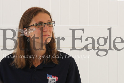 Jennie Hendrickson watches her husband Justin Hendrickson, a U.S. veteran who lost a leg serving in Iraq, deliver a speech at the celebration for the home the couple recieved from Homes for Troops. Seb Foltz/ Butler Eagle 08/03/19