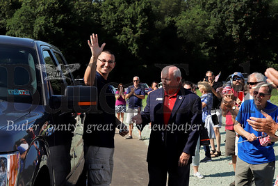 U.S. veteran Justin Hendrickson is welcomed to his new home by retired  brigadier general and Homes for Troops president/CEO Tom Landwermeyer, area residents, friends and family Saturday 08/03/12.  Seb Foltz/Butler Eagle