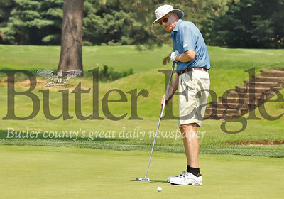 George Bilowick watches his  putt roll to the cup on the 2 hole at Butler Country Club Monday. Seb Foltz/Butler Eagle  (home course)