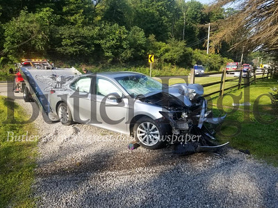 A portion of Route 228 east in Middlesex Township is closed after a car crash about 8 a.m. Monday sheared off a utility pole and knocked down power lines. The road is closed between Sandy Hill and Logan roads while West Penn Power crew responds.Jim Smith/Butler Eagle