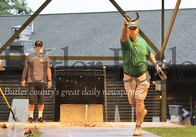 Bob McKee of Slate Lick throws a horseshoe for O'Donnell's Distributor team in a league game at the Dew Drop Inn Tuesday. Seb Foltz/Butler Eagle 08/04/20 (Rich Hans of Herman also pictured)