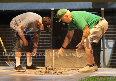 Bob McKee and Rich Hans retrieve horseshoes during a league game at the Dew Drop Inn Tuesday. Seb Foltz/Butler Eagle 08/05/20