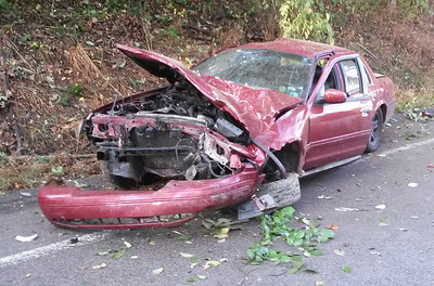 The woman driving this car was taken to Butler Memorial Hospital with injuries Tuesday morning after the car struck an embankment and rolled back down to the road in Middlesex Township.