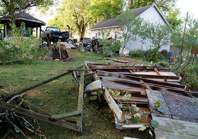 The wood and metal roof of a carport dislodged and landed in a vegetable garden at 138 West Main St. during Tuesday's severe thunderstorm in Worthington. Seb Foltz/Butler Eagle