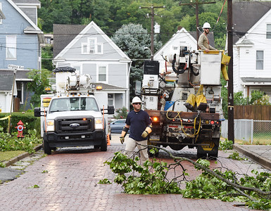 Harold Aughton/Butler Eagle: A West Penn Power crew from Waynesboro repair down electric lines on Beckeit Street in the Island Section of Butler Friday, August 28, 2020.