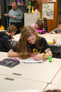 A student in Ezekiel Stroupe's class reads a diary entry written by a teenage Holocaust victim living in the Lodz Ghetto in Poland during WWII.