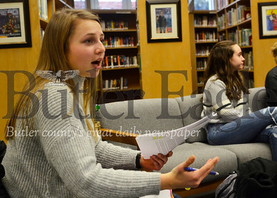 Eliza Drohan, 17, of Butler answers a line of witness questioning in a practice session Wednesday. Drohan is a senior on mock trial team at Butler Senior High School. Fresh off a county-level win, she's part of the team training up for the upcoming district competition.