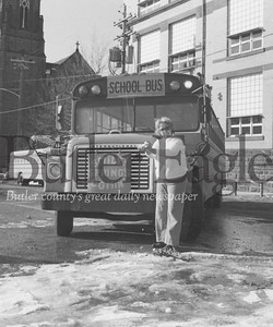 "SMILE TIME - ""Smile! Spring's Comin'"" reads the sign on the front of the bus No. 68 driven by Harriet Sankey, and the weatherman agrees. FEBRUARY 28, 1979"