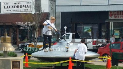 "It's ""secret Martians"" painting the spaceship in the center of town in advance of the 2nd annual Mars New Year, to be held from May 4 - 6 in downtown Mars."