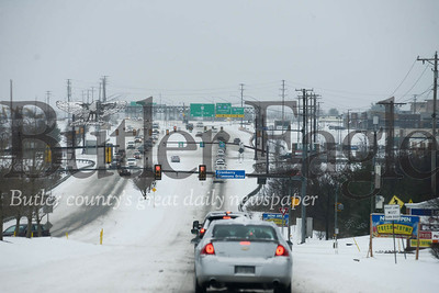 Photos by J.W. Johnson Jr.1: Motorists navigate snow-covered roadways Wednesday on Route 228 in Cranberry Township.