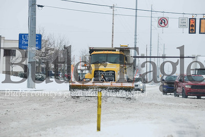Photos by J.W. Johnson Jr.2: A snow plow makes its way up Route 19 on Wednesday in Cranberry Township.