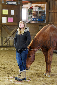 "Harold Aughton/Butler Eagle: Lea Zancha, a school based therapist at Glade Run, stands inside a hula hoop as Hersey, a quarter horse/thoroughbred mix,  investigates as part of the ""Horses at Liberty"" excise part of the Equine Assisted Wellness Workshop at Glade Run Adventures, Sunday, February 2, 2020."