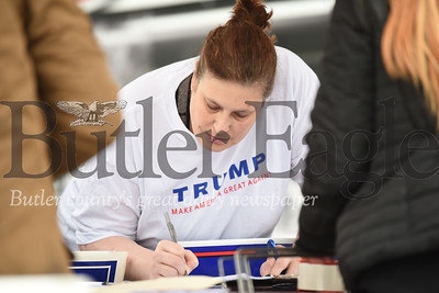 Harold Aughton/Butler Eagle: Trump supporter Kris West of Butler signs a petition to relect Donald Trump.
