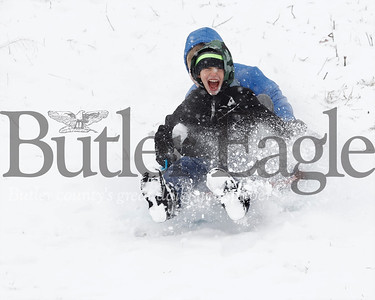 Christian Wary, 9, and Zach Zolkowski, 11, of Cranberry double up for a sled ride at North Boundary Park in Cranberry Township Friday. With schools across Allegheny and Butler counties closed kids and adults alike took to local parks to enjoy the fresh snow. Seb Foltz/Butler Eagle