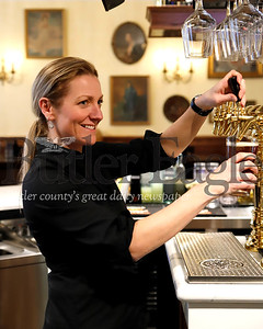 Kaufman Tavern bartender Teri Spence pours a beer from North Country Brewing Company. The new restaurant located in the remodled Kaufman House on Main Street in Zelienople, boasts over 40 taps with beers and ciders. Seb Foltz/Butler Eagle