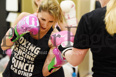 Harold Aughton/Butler Eagle: Instructor Lisa Guerrini, takes a jab at her partner druing a recent couple boxing class at the Cranberry YMCA.