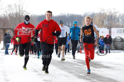 Kyler Woolstrum, 12, (right) and Bobby Danielson (center) lead a pack of runners off the starting line at Lake Arthur Golf Club Saturday. Close to 50 runners from around the region braved temperatures in the high 20s Saturday morning to participate in Butler's Cupid Chase 5K. The race, part of a national event with other 5K runs in Pittsburgh and Latrobe,  raises money and awareness residential and employment services for individuals with disabilities. Seb Foltz/Butler Eagle