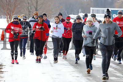 Close to 50 runners from around the region braved temperatures in the high 20s Saturday morning to participate in Butler's Cupid Chase 5K at Lake Arthur Golf Club. The race, part of a national event with other 5K runs in Pittsburgh and Latrobe,  raises money and awareness residential and employment services for individuals with disabilities. Seb Foltz/Butler Eagle