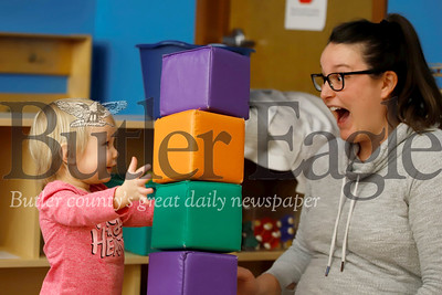 Corbin Bargo, 2, of Meridian prepares to knock over a block stack she built with her mom Brynn Bargo in the kids play area at the Butler Area Public Library Wednesday. Seb Foltz/Butler Eagle