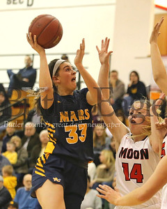 Mars' Bella Pelaia take a shot against Moon's Emma Theodorsson (#14) and Sarah Santicola (#15) in Tuesday night's playoff game at North Hills. Seb Foltz/Butler Eagle