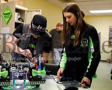 Josh Wollerton, 17, and Lindsey Gourash, 15, troubleshoot an issue with their team robot 'Schodinger.' Seb Foltz/Butler Eagle