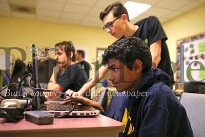 Rohan Cherlakola, 13, Luke Kastner, 14, and Matthew Gourash, 17, working on programing for team robots. Seb Foltz/Butler Eagle