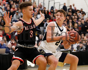 Knoch's Scott Fraser(2) pumpfakes a shot against New Castle's Donny Cade (3). New Castle topped the Knights 56-55 in Saturday's WPIAL playoff at North Allegheny.Seb Foltz/Butler Eagle