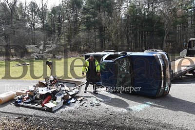 Middlesex Township Officer Conrad Pfeifer inspects the aftermath of a single vehicle crash on Reamer Road.