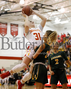 North Catholic's  Belle O'Hara 31  shoots over Jolie Strati of Blackhawk WPIAL PLAYOFF . Seb Foltz/Butler Eagle