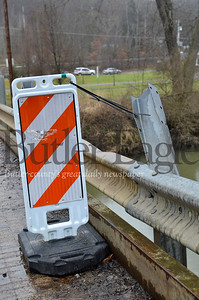 A car turns around on Meridian Road, as the path's bridge over the Connoquenessing Creek is closed. Tanner Cole/Butler Eagle