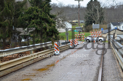 A semi-truck driver hit the guard rail, pulling a section off the bridge. PennDOT staff closed the bridge as a safety precaution until the rail is replaced, but no structural damage was found. Tanner Cole/Butler Eagle