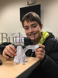 Tommy Edwards, 8 of Renfrew, shows off the cat he made as part of the Butler Public library Happy Mew Year event that took place on Jan. 2, 2019.image2.jpeg