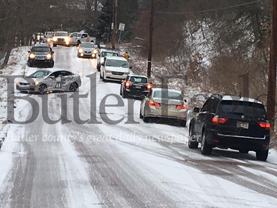 Icy road conditions turned North McKean Street, pictures, and other roads in the area into a sheet of ice Wednesday, Jan. 9 during rush hour traffic. Over 10 cars were pulled to the side of the McKean Street according to emergency dispatch.
