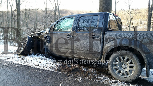CUTLINE: One person was taken to Butler Memorial Hospital for serious injuries after a two-vehicle accident on Mahood Road Friday afternoon. Two vehicles, a pickup truck and an SUV, clipped one another heading opposite directions on Mahood Road just west of Thompson Road around 2:30 p.m..