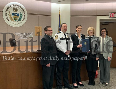 The county commissioners issued a proclamation honoring the achievements of Marissa Slupe, who hopes to attend the Air Force Academy this fall.  Pictured are Commissioners Kevin Boozel; Marissa's uncle, Sheriff Mike Slupe; Marissa Slupe; and commissioners Leslie Osche and Kim Geyer.