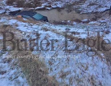 A 2012 Volkswagen sedan landed in a creek Thursday morning after skidding off an icy road in Jackson Township. Police said the driver, who lives nearby, was not injured.