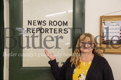 Paula Grubbs, a reporter for the Butler Eagle, stands by the newsroom door before main office operations move from West Diamond Street to West Wayne Street after 95 years.
