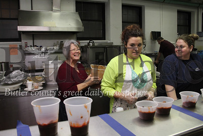 Carol Landis, left, one of the organizers for 12th Annual Chili Cook-Off in Butler, serving chili photos taken by Eric Jankiewicz