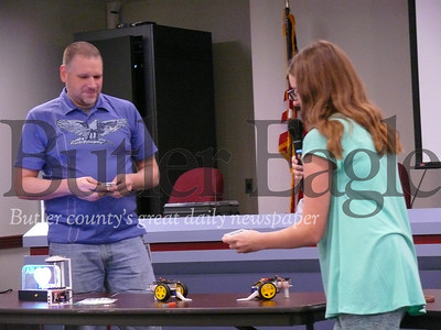 "Alli Bearer, right, and her father, Jeff Bearer, show off Alli's ""battle bots"" creation Tuesday during a Cranberry Coffee and Conversation event at the township municipal building."