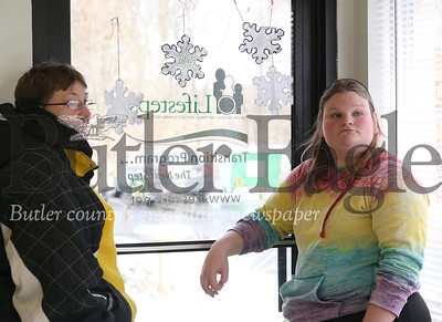 Lifesteps program members Renee (left) and Kate chat in the entry before heading out for a life skills program. Seb Foltz/Butler Eagle