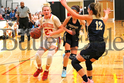 North Catholic's Tess Myers drives to the hoop against Freeport's  Maddie Clark (15) and Samantha Clark (12) in Thursday's 61-42 home win. Myers led the Trojanettes with 21 points. Seb Foltz/Butler Eagle