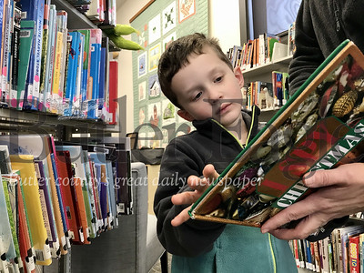 Will Pyda, 4, was the first participant to reach the 100 book milestone in the Slippery Rock Community Library's program with the challenge to have parents read 1,000 books to their newborn, infant and toddler before kindergarten. Photo by Gabriella Canales.