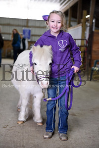 Harold Aughton/Butler Eagle: Lily Burns, 8, with minature horse, Bunny.