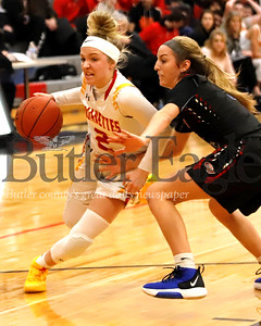 North Catholic's  Emma Pospisil #2 drives to the lane past Chartiers Valley's Helene Cowan #5 in Saturday's 72-44 loss at North Catholic. Seb Foltz/Butler Eagle
