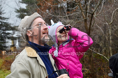 Andy Zadnik holds up Addie Zadnik so she can get a better look at a bird at Succop Nature Center. Tanner Cole/Butler Eagle