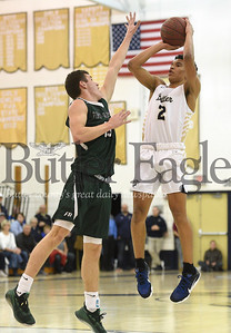 Pine Richland's Kyle Polce attempts to block a shot by Butler's Devin Carney during the basketball game at Butler High School on Tuesday, Jan. 7, 2020. (Photo By: Erica Dietz)