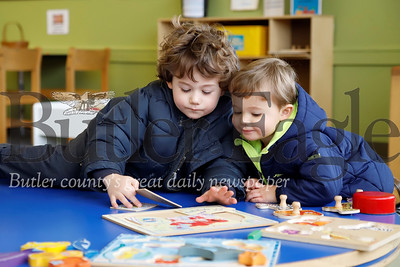 Luca Colella(left), 3, and his brother Vito,2, work on a puzzle in the children's section of the Cranberry Library Tuesday. Seb Foltz/Butler Eagle 01/07/12
