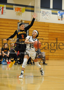 North Cathloic #2  Emma Pospisil goes up to block Knoch #25 Nina Shaw during a game at Knoch Gym on Monday January 13, 2020 (Jason Swanson photo)